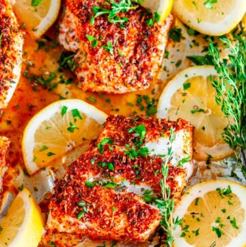 Sheet Pan Paprika Parmesan Cod with Broccoli in foil with lemons and herbs