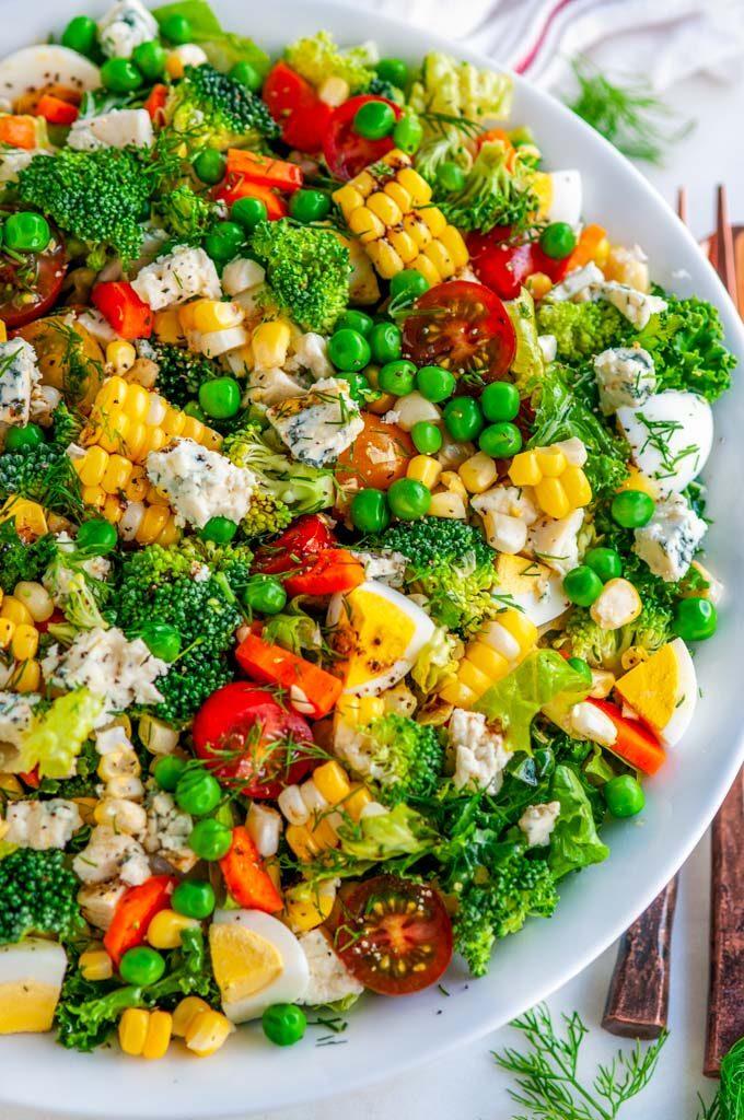 Summer Harvest Chopped Veggie Salad in white bowl on white marble