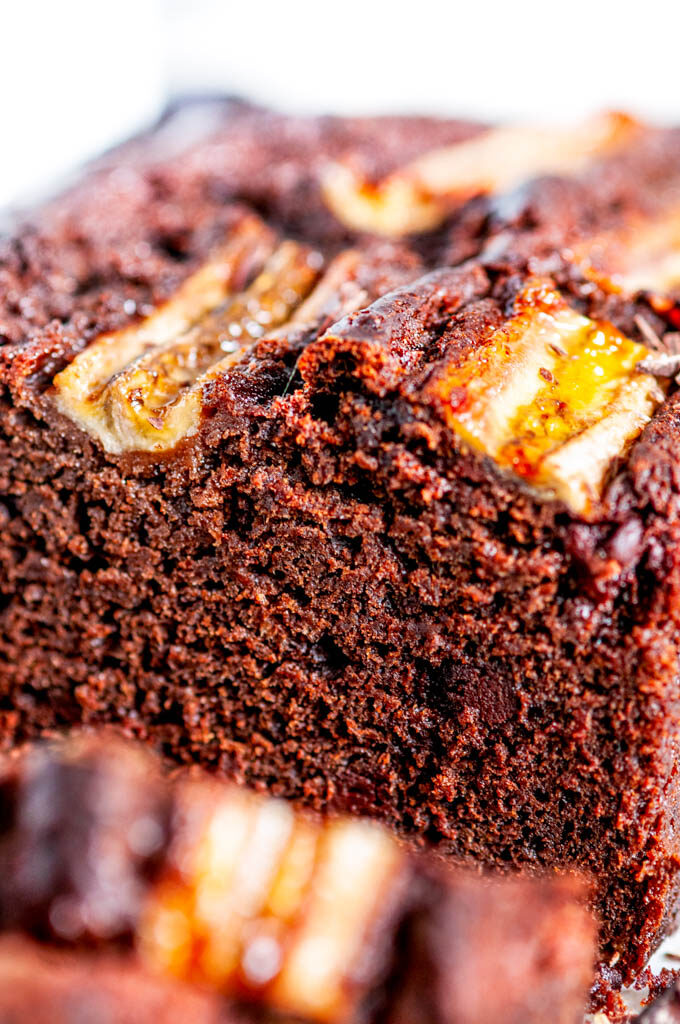 Double Chocolate Banana Bread slice close up with chocolate chunks