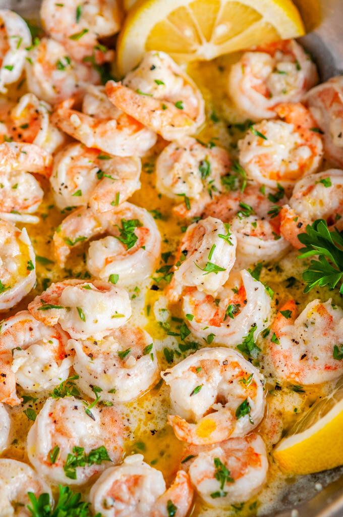 Garlic Butter Shrimp Scampi skillet with lemon slices and parsley close up