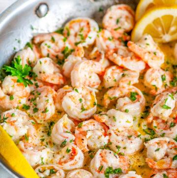 Garlic Butter Shrimp Scampi skillet with lemon slices and parsley in skillet