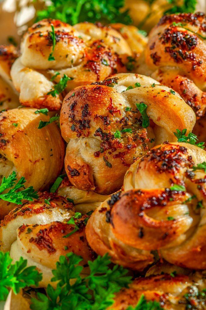 Herb Garlic Parmesan Knots with parsley close up