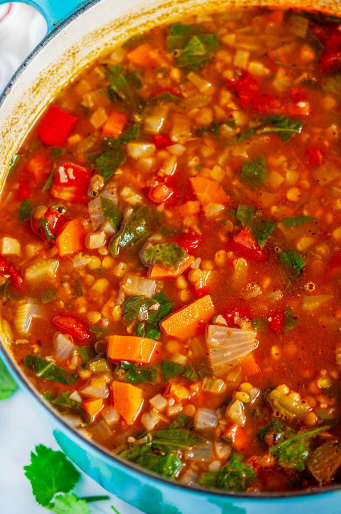 One Pot Vegetable Lentil Stew in blue le creuset pot close up