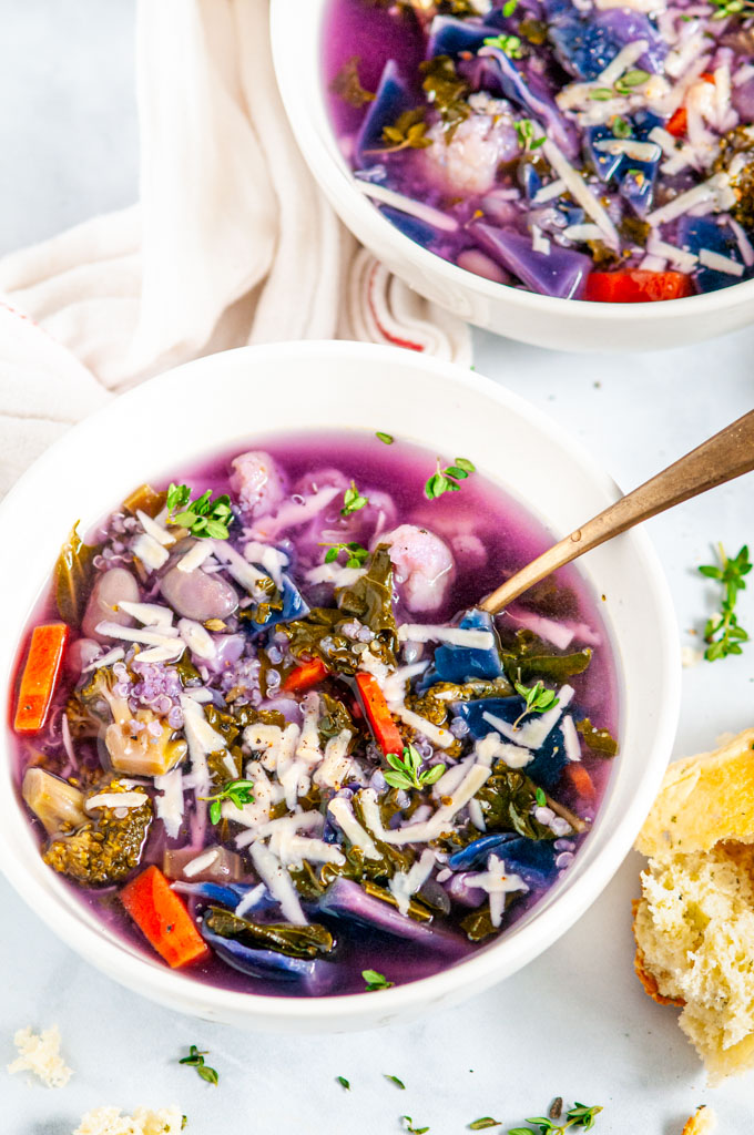 White Bean Purple Cabbage Soup with gold spoons in white bowls