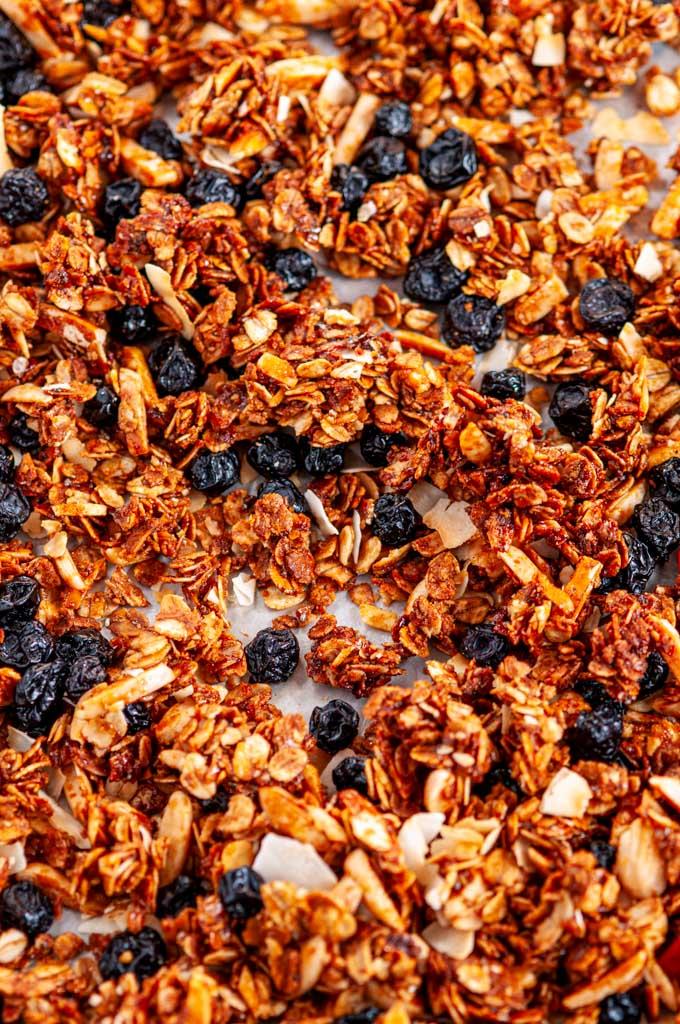 Blueberry Almond Coconut Granola on baking sheet close up