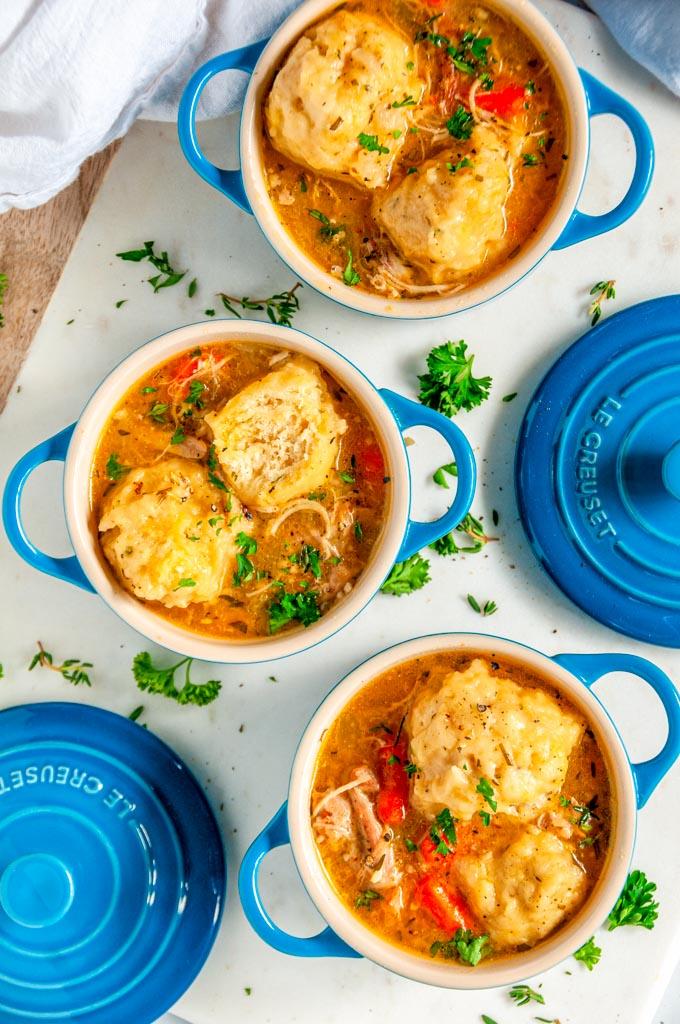 Instant Pot Chicken Dumpling Soup in blue le creuset cocettes on white marble