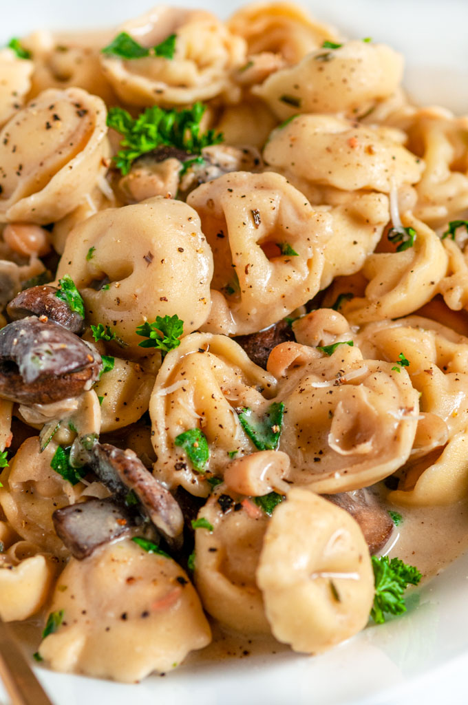One Pot Creamy White Bean Tortellini with mushrooms close up