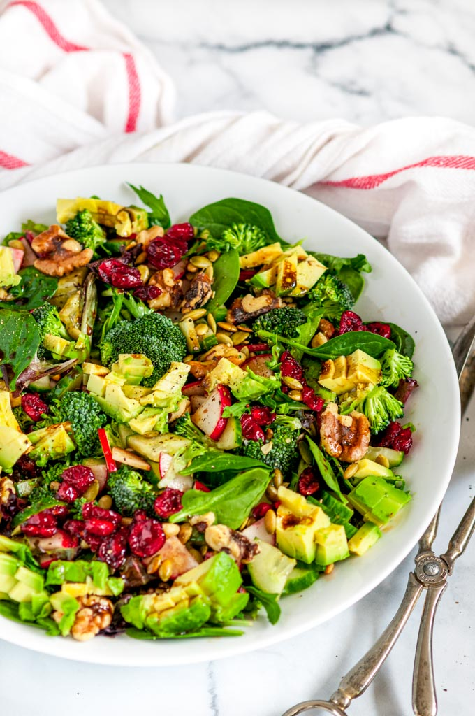 Easy Everyday Side Salad in white bowl on marble with tea towel