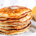 Lemon Poppy Seed Buttermilk Pancakes on gray plate with tea towel close up