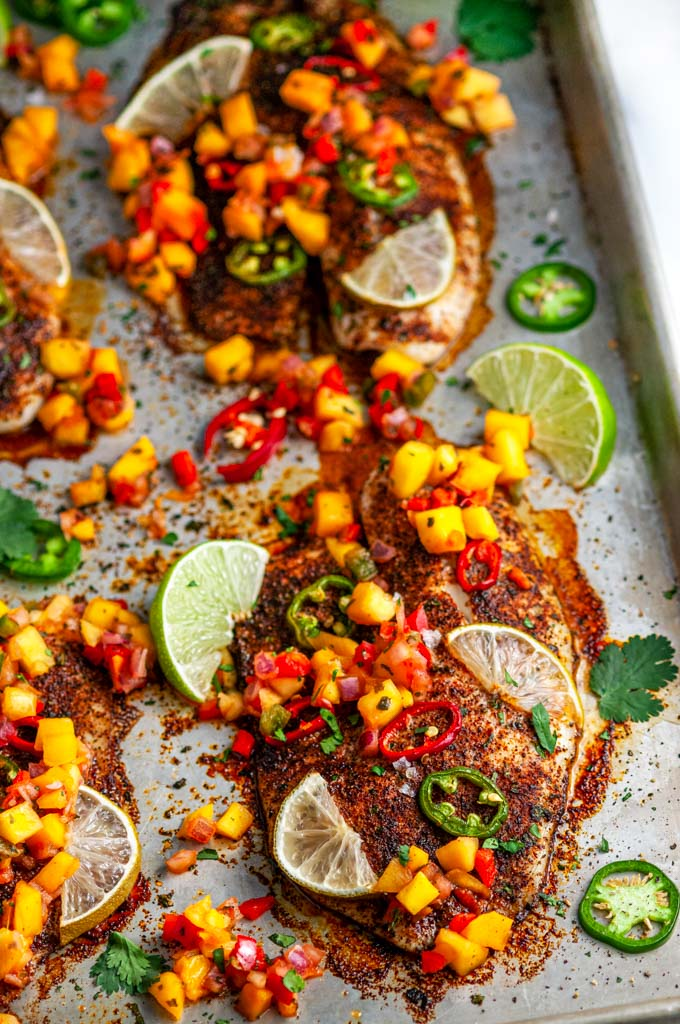 Sheet Pan Chili Lime Tilapia with mango salsa on sheet pan close up