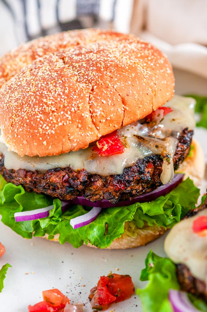 Chicken Chipotle Burgers with pepper jack cheese and pico de gallo close up