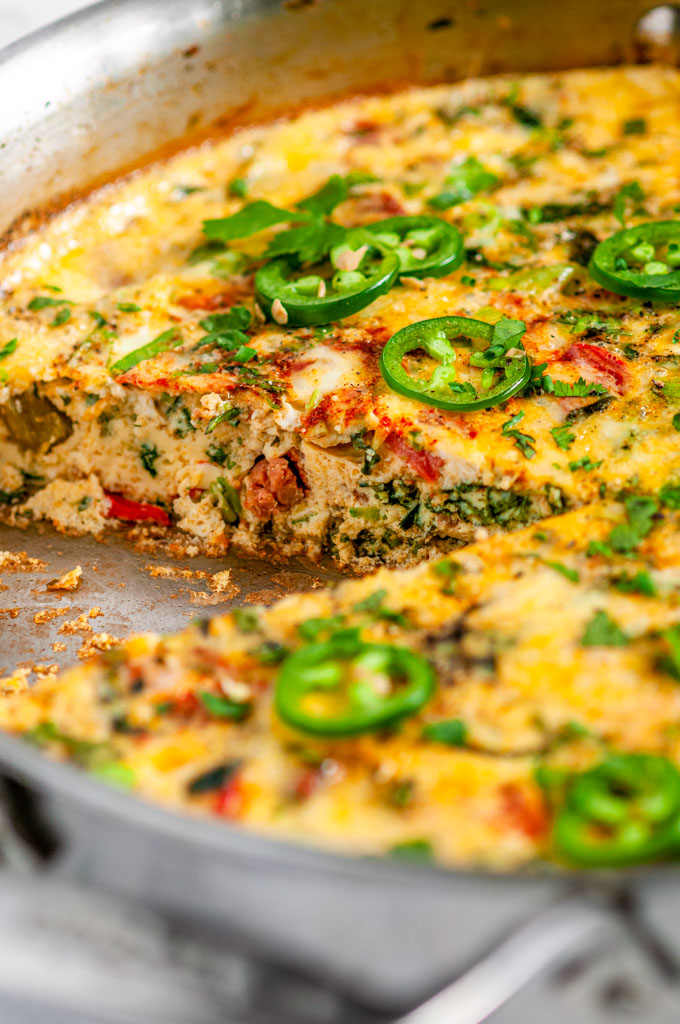 Chorizo Vegetable Frittata in all clad skillet with slice removed close up
