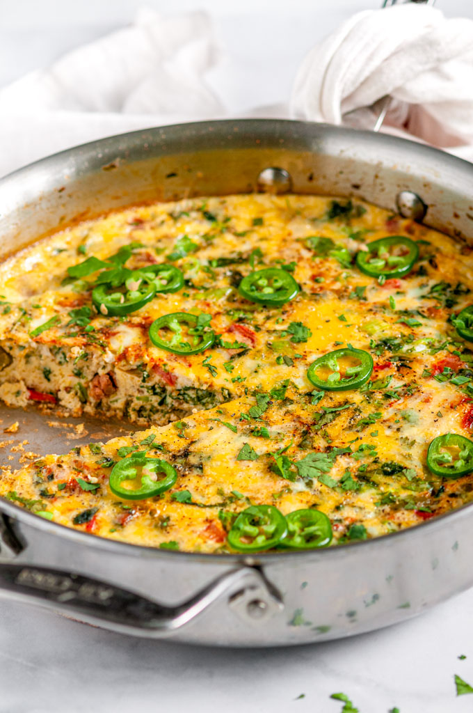 Chorizo Vegetable Frittata in all clad skillet with slice removed