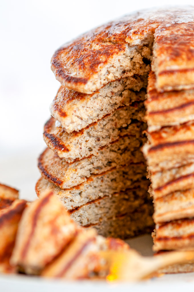 Fluffy Banana Oat Pancakes (Gluten Free) stack slice cut out close up side view