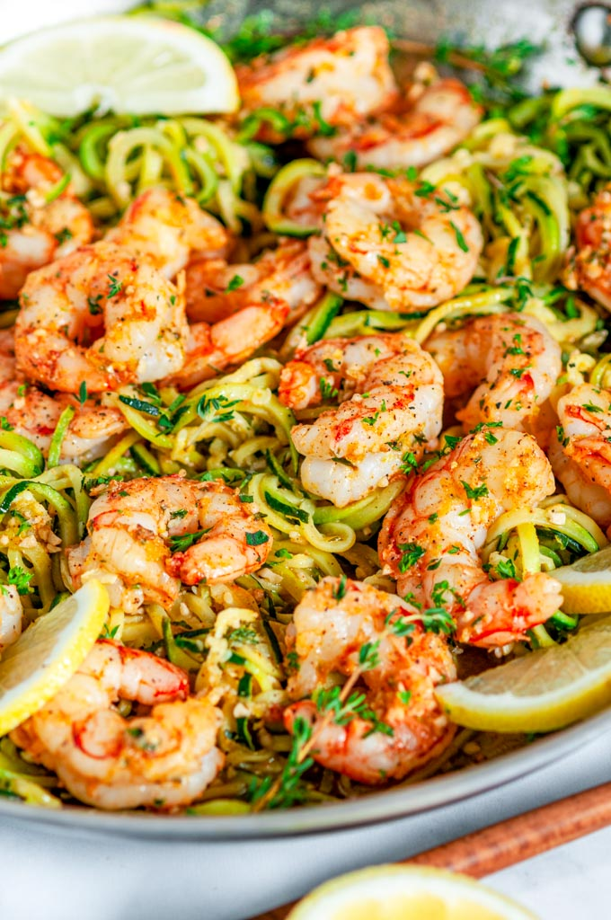 Skillet Shrimp Zucchini Noodles with lemon in silver all clad skillet close up side view