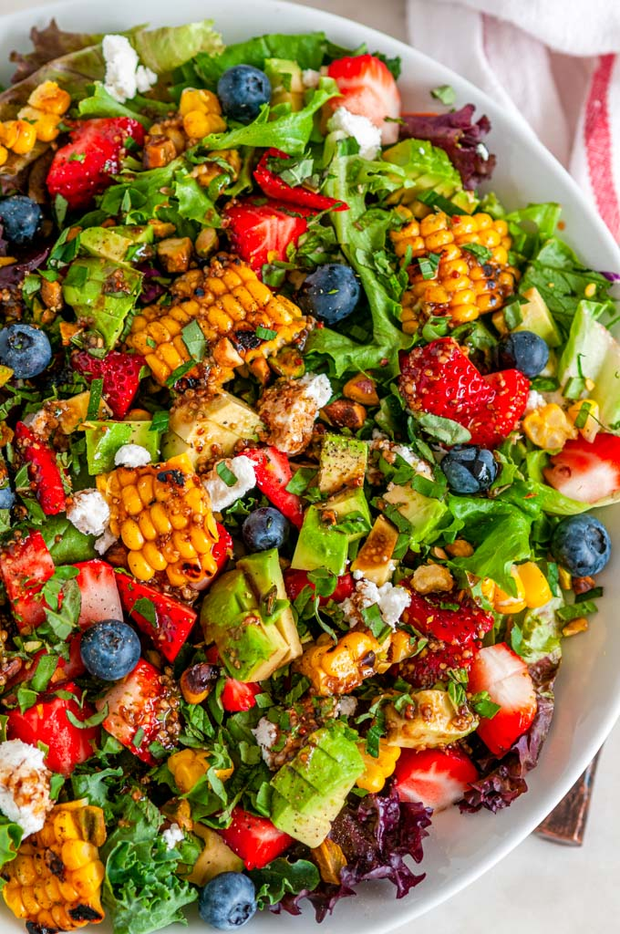 Strawberry Avocado Corn Salad in white bowl over view close up