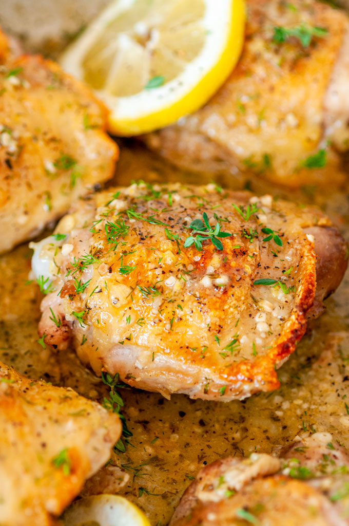Skillet Lemon Dill Chicken Thighs in all clad pan side view close up