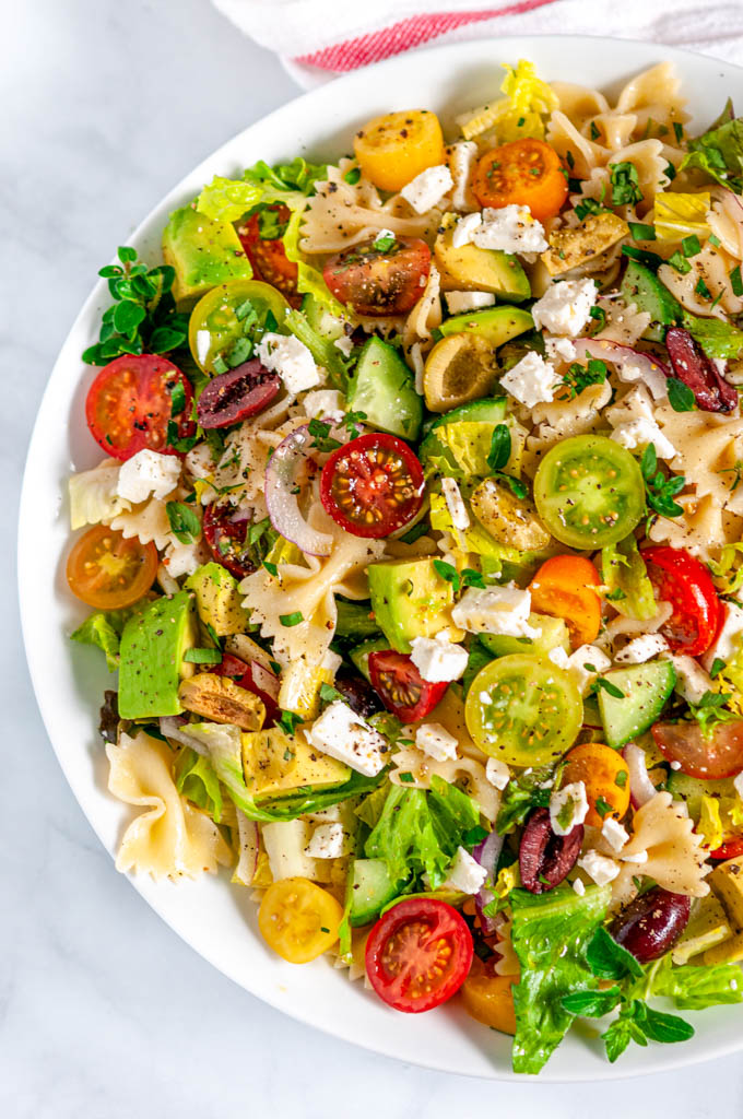 Summertime Greek Pasta Salad in white bowl overhead view close up