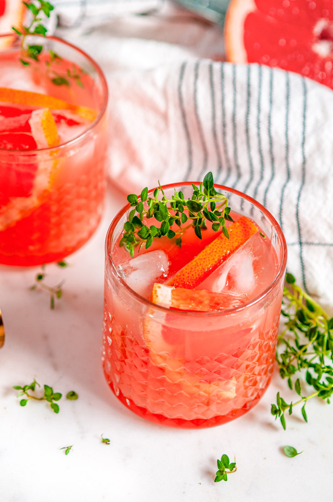 Grapefruit Thyme Gin and Tonic on white marble side view