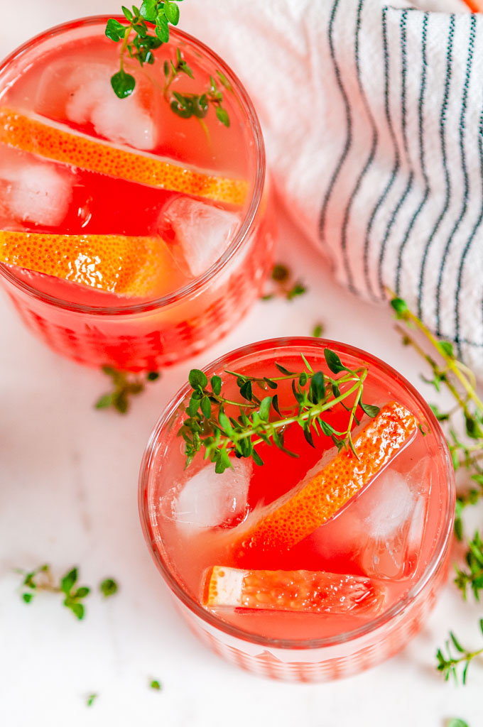 Grapefruit Thyme Gin and Tonic on white marble over head close up view