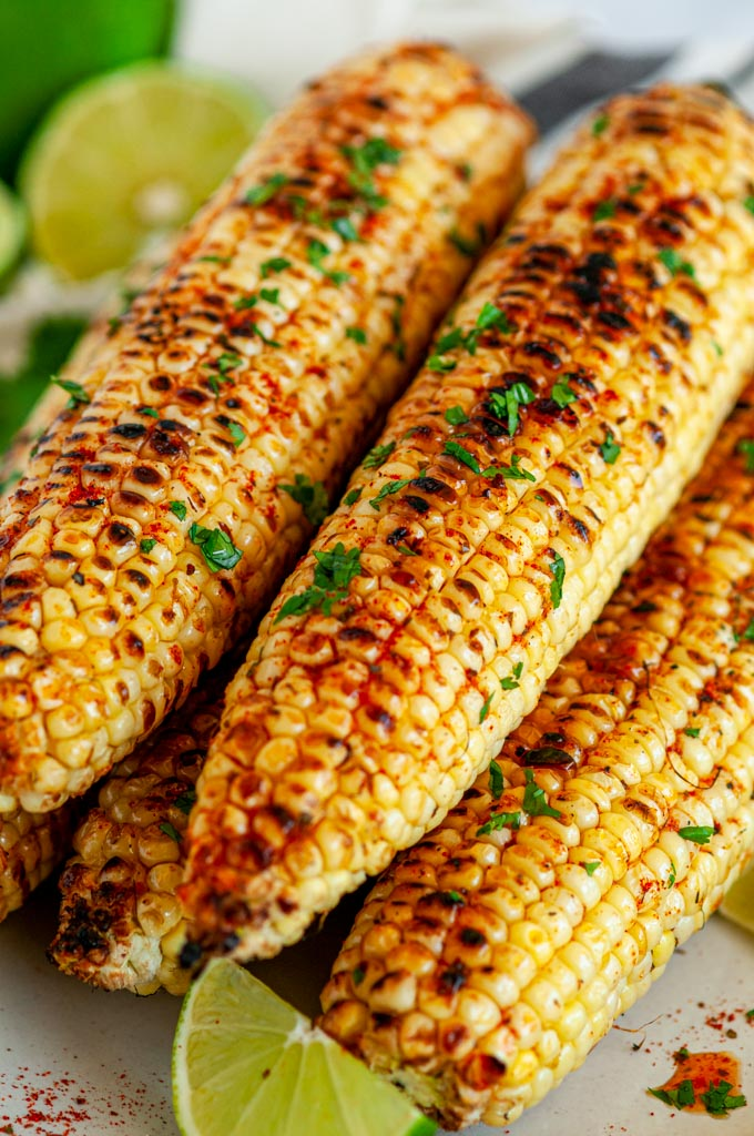 Grilled Chili Lime Honey Butter Corn on the Cob side view close up
