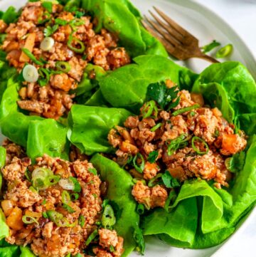 PF Chang's Chicken Lettuce Wraps (Copycat Recipe) on gray plate with gold fork close up