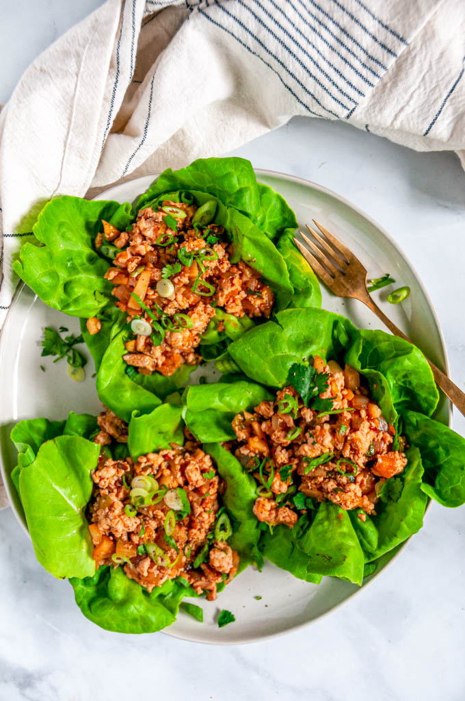 PF Chang's Chicken Lettuce Wraps (Copycat Recipe) on gray plate with gold fork