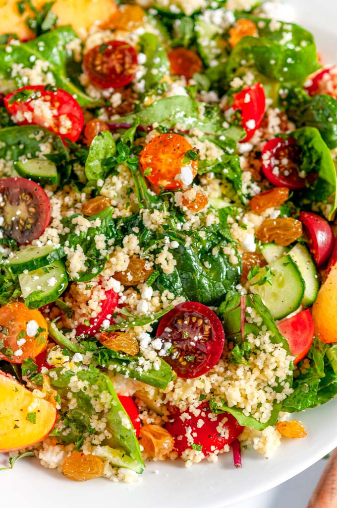 Summer Harvest Couscous Salad in white bowl close up