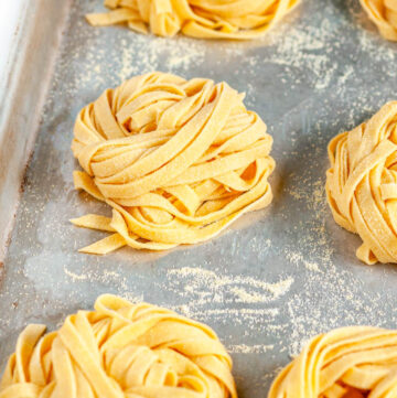 Homemade Pasta Dough Recipe nests on baking sheet