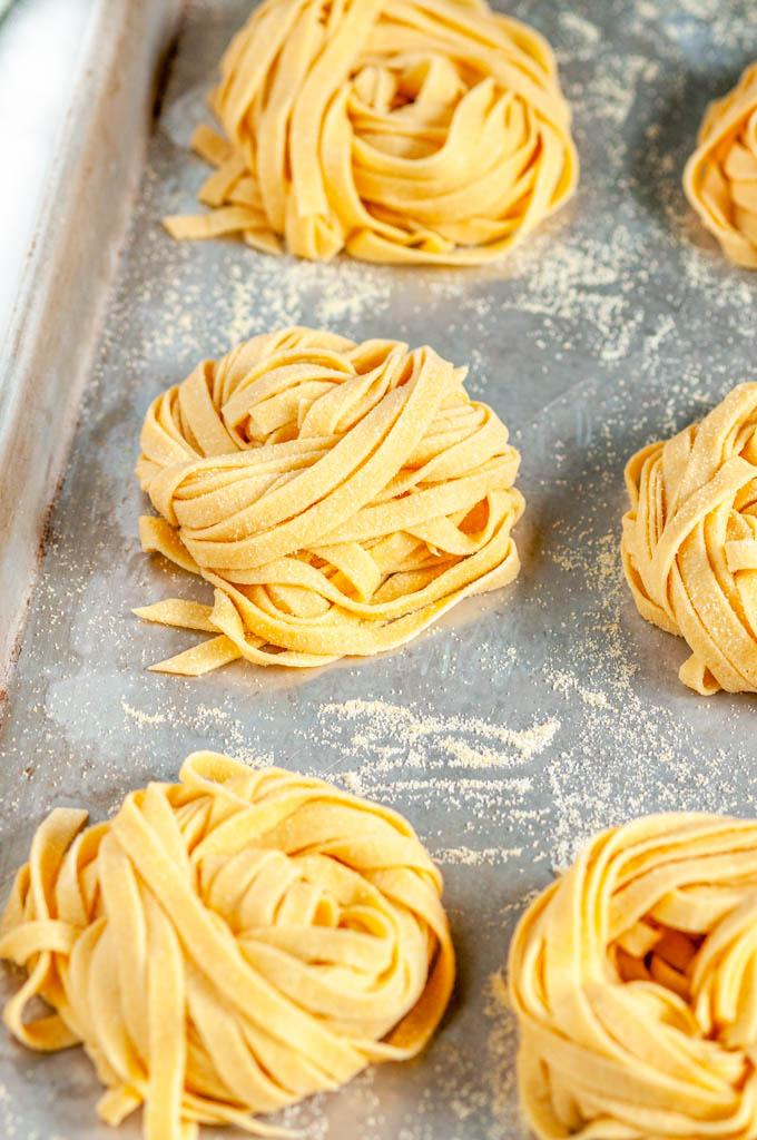 Homemade Pasta Dough Recipe nests on baking sheet