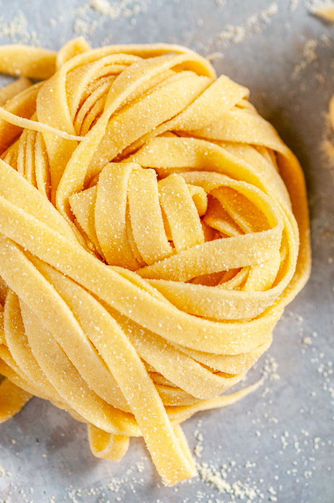 Homemade Pasta Dough Recipe nest on baking sheet close up