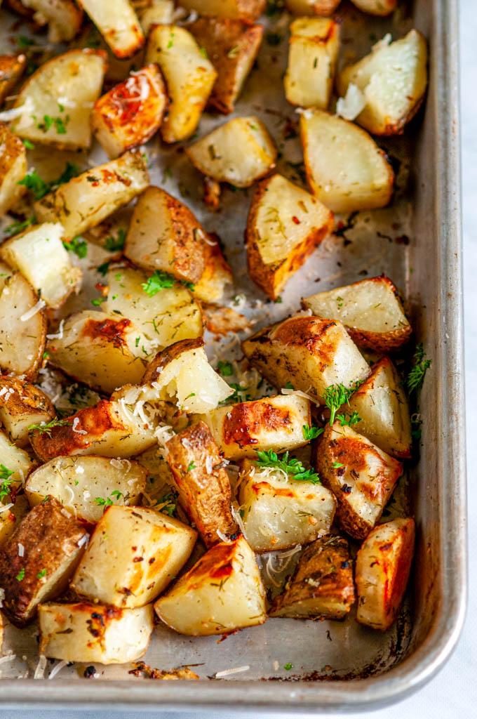 Parmesan Garlic Roasted Potatoes on sheet pan close up
