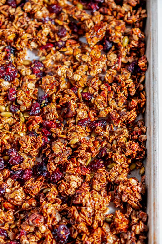 Chai Spice Cranberry Pecan Granola on sheet pan