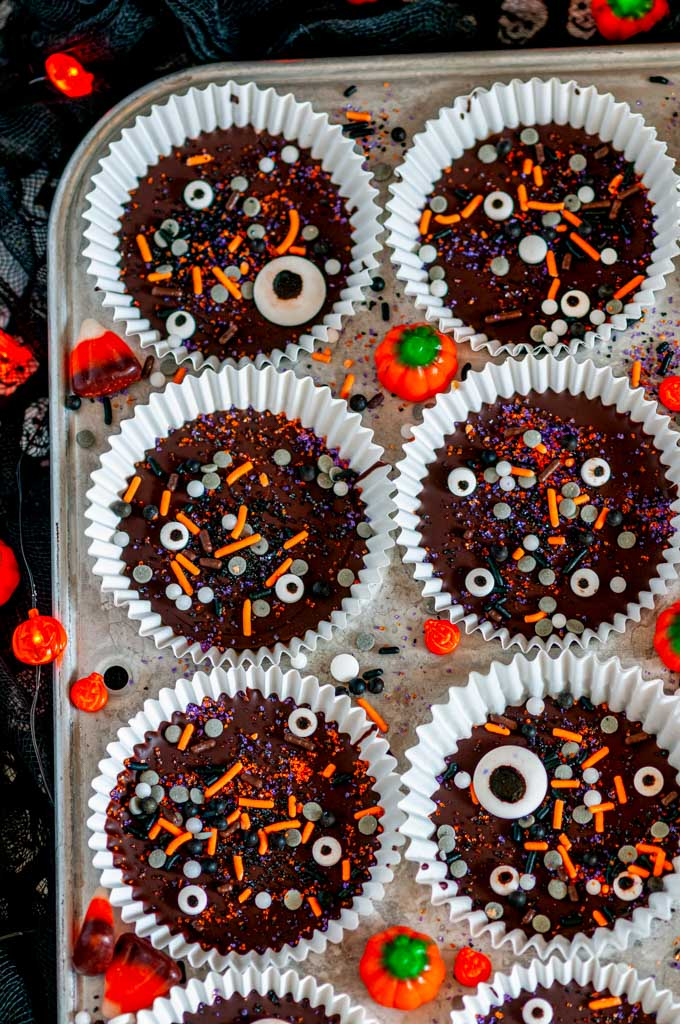 Dark Chocolate Peanut Butter Cups (Halloween Style!) with sprinkles in white muffin liners and tray