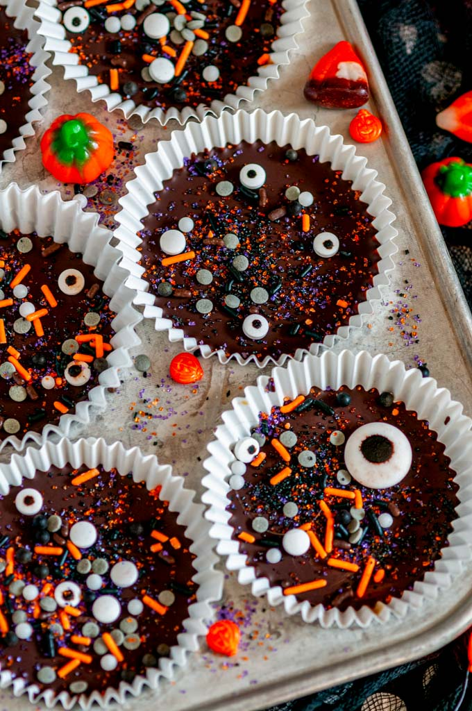 Dark Chocolate Peanut Butter Cups (Halloween Style!) with sprinkles in white muffin liners and tray close up