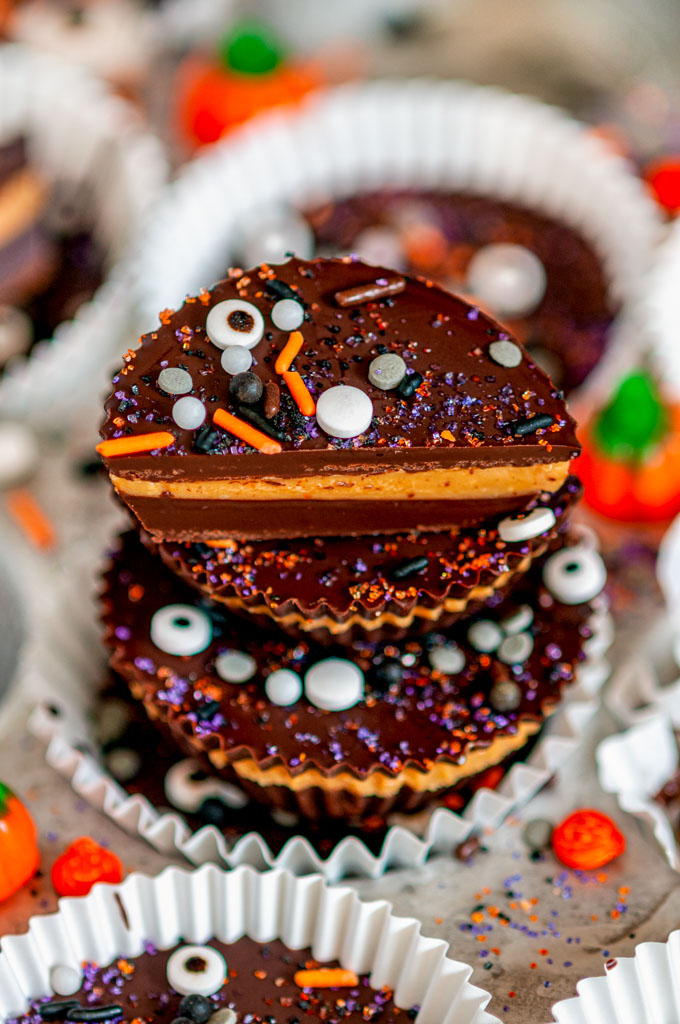 Dark Chocolate Peanut Butter Cups (Halloween Style!) with stack with sprinkles in white muffin liners and tray