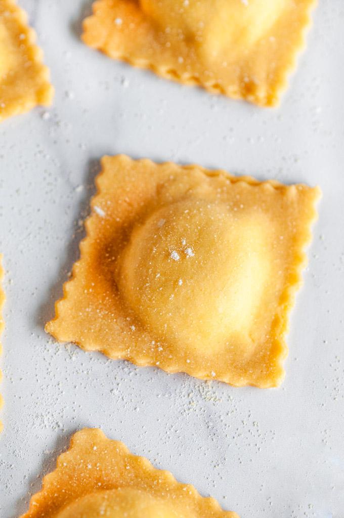 Herbed Three Cheese Homemade Ravioli uncooked close up