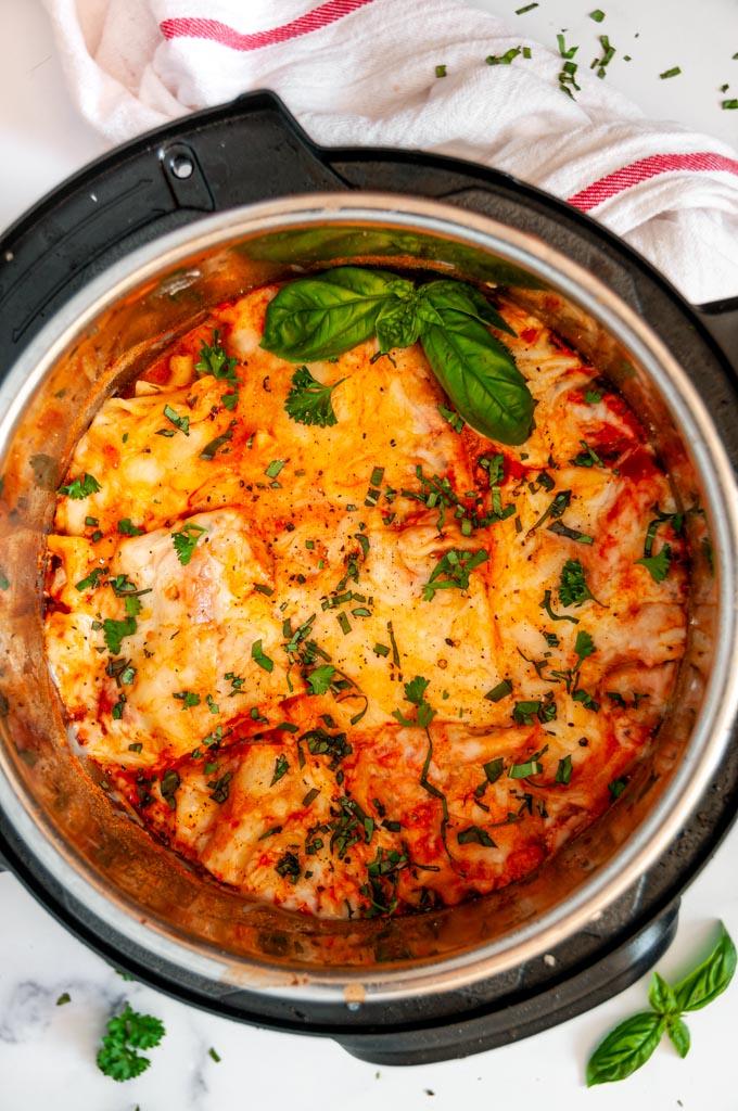 Instant Pot Turkey Vegetable Lasagna with fresh basil and tea towel