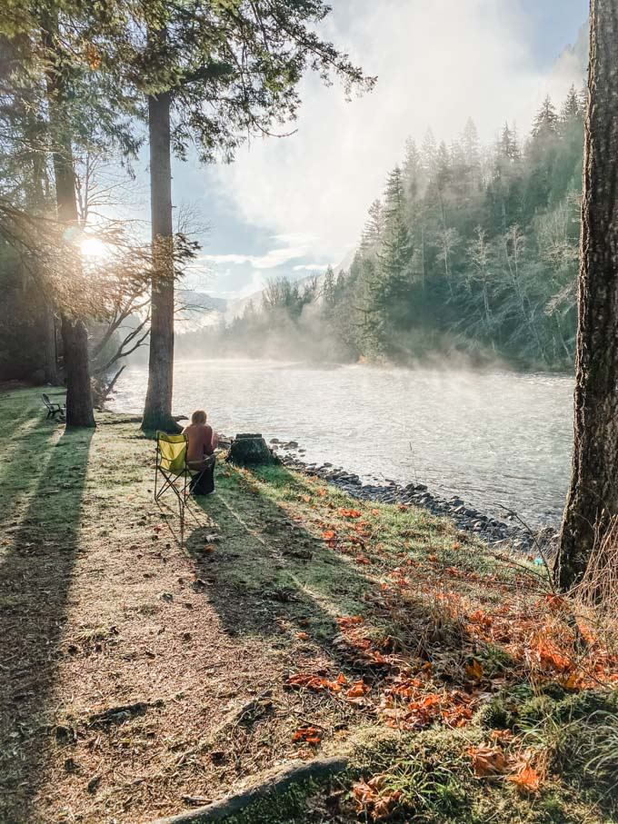 Giving Thanks (Out of the Kitchen) Blond Woman Sitting in Camping Chair by Mountain River