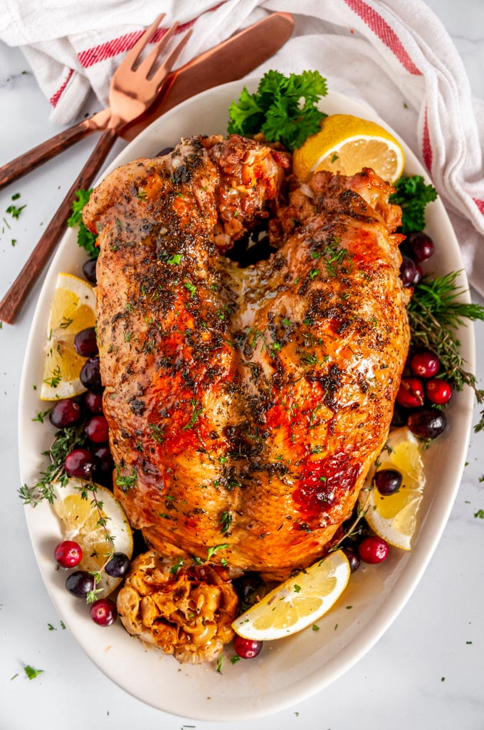 Instant Pot Turkey Breast with lemon and garlic on white platter