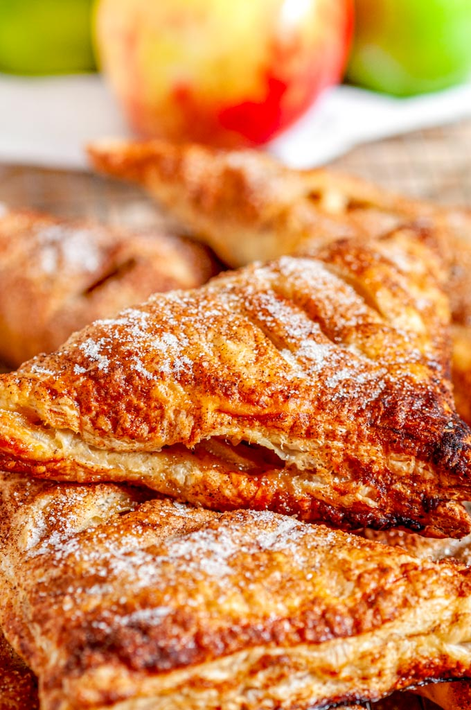Puff Pastry Apple Turnovers with white towel close up