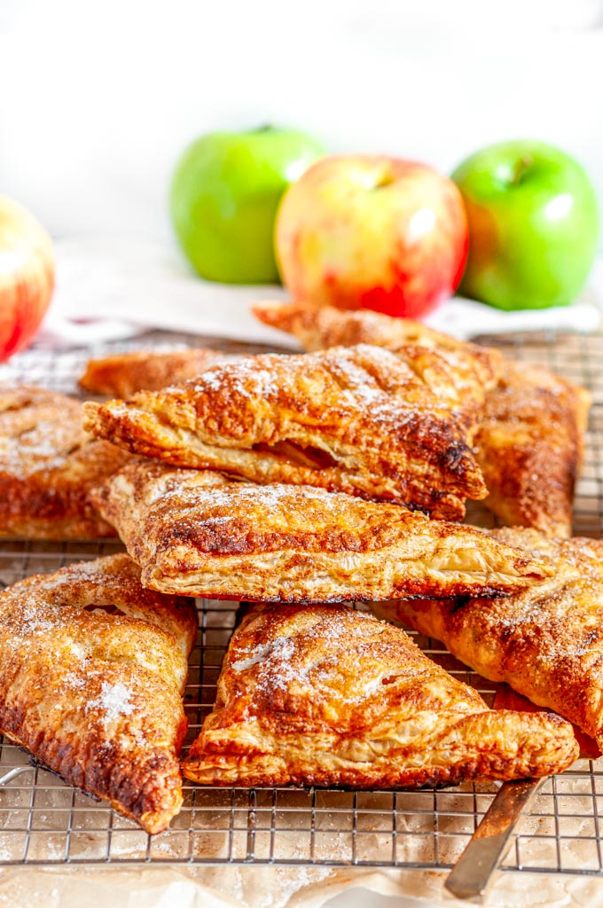 Puff Pastry Apple Turnovers on silver wire rack with white towel
