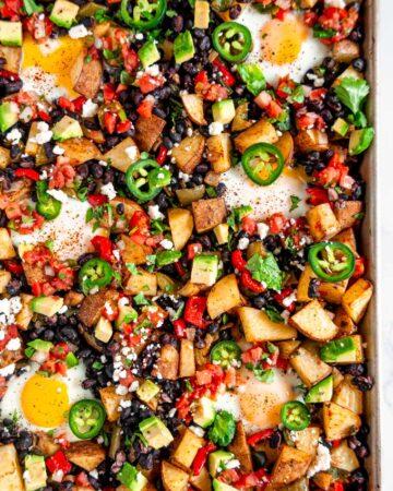 Vegetarian Sheet Pan Mexican Breakfast on white marble