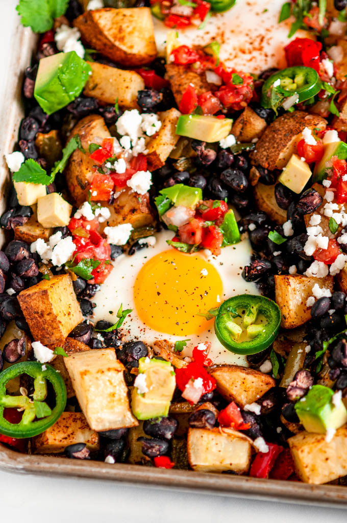 Vegetarian Sheet Pan Mexican Breakfast on white marble close up