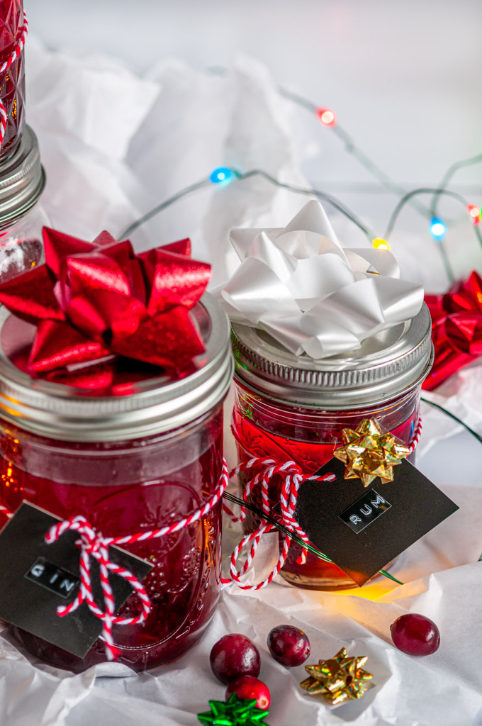 Boozy Cranberry Sauce Gift Jars with ribbon and gift tags on tissue paper and white marble