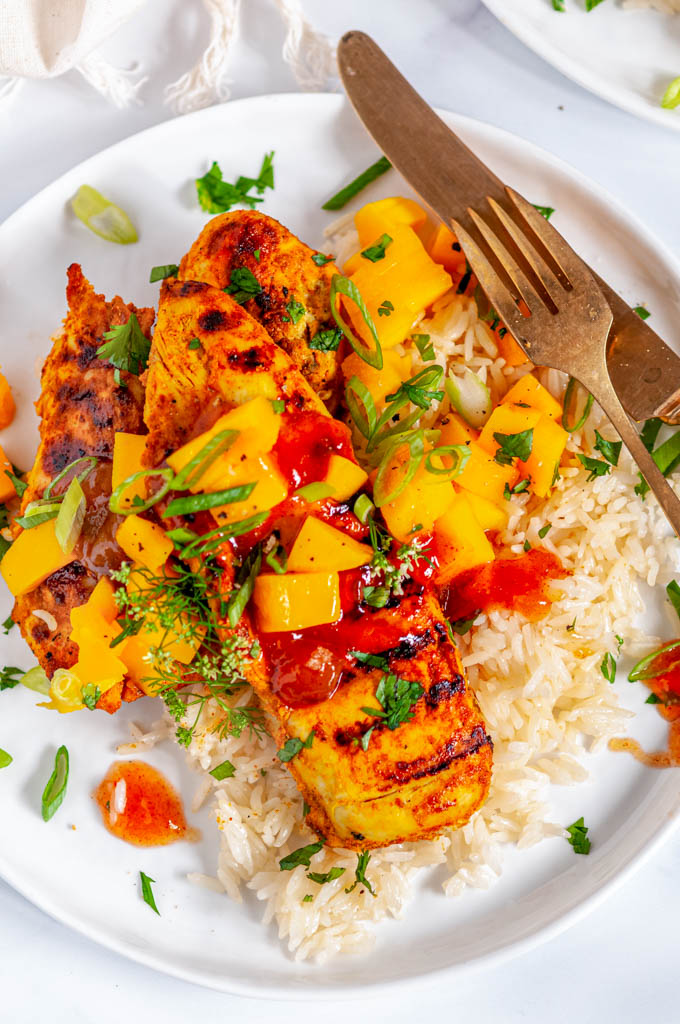 Easy Grilled Tandoori Chicken on white plate with gold silverware