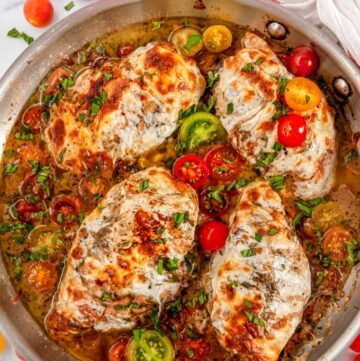 Quick & Easy Skillet Chicken Caprese with cherry tomatoes and pan sauce in All-Clad Skillet