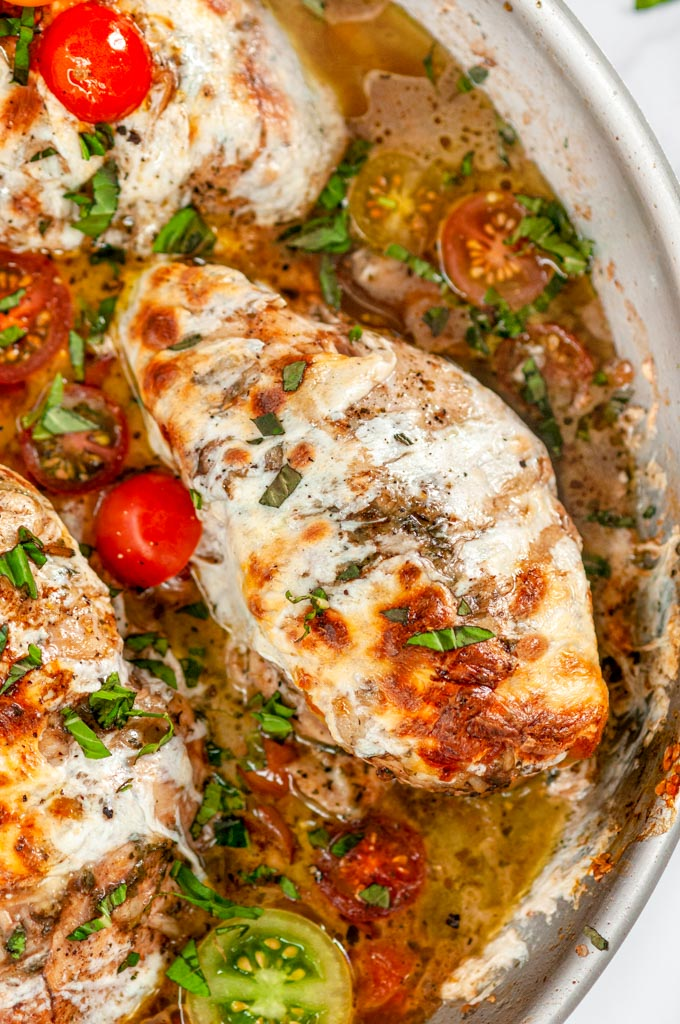 Quick & Easy Skillet Chicken Caprese with cherry tomatoes and pan sauce in All-Clad Skillet close up