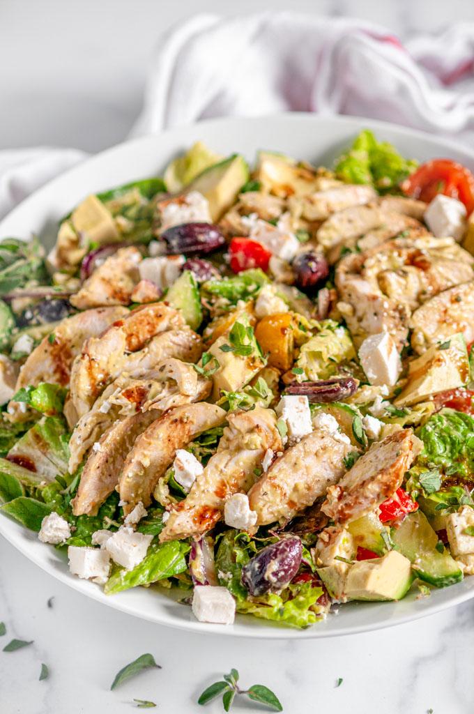 Greek Avocado Chicken Salad in white bowl on white marble