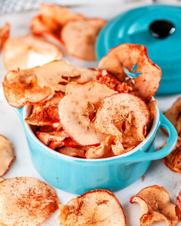 Healthy Baked Apple Chips in mini aqua blue cocette on white marble